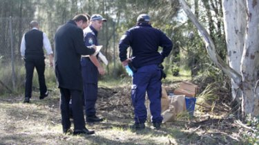 Sad find ... police at the Nurragingy Reserve.