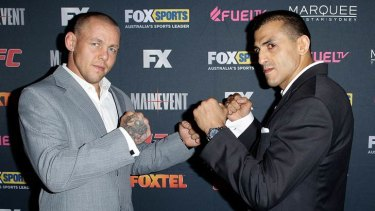 Australian coach George Sotiropoulos (right) faces off against Team UK coach Ross Pearson at the television launch of The Ultimate Fighter: The Smashes.
