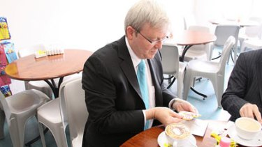 Kevin Rudd posts picture of himself eating a biscuit.