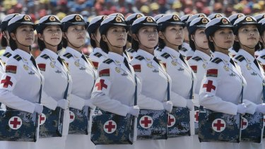 Female Chinese soldiers of the medical corps ride in trucks during the military parade on Thursday last week: The holiday to commemorate the end of World War II couldn't have come at a better time for markets.