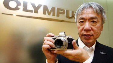 """The market for compact digital cameras shrank at a faster speed and scale than we had imagined"" ... Hiroyuki Sasa, Olympus president."