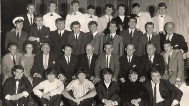 Flash back: (back row, far right): Noel Tresider; Johnny Devlin (third from right); Johnny Chester (fourth from right; members of the group The Phantoms (in white suits). Seated: Kenn Brodziak (centre); Dick Lean (fourth from right). Sitting on floor: (from left to right): Alan Field; George Harrison; Paul McCartney; John Lennon; Ringo Starr; Derek Taylor.