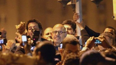 Outspoken ...Mohamed ElBaradei, centre, attends a demonstration in al-Tahrir square in Cairo.