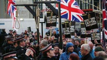 Protesters, many from far-right political organisations, demonstrate outside the court.