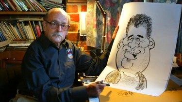 Bill Green, aka WEG, with one of his trademark caricatures.