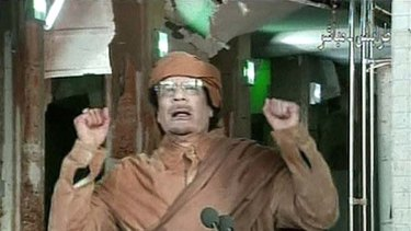 """""""I will die a martyr"""" ... Muammar Gaddafi  delivers a tirade against anti-government protesters on state television."""