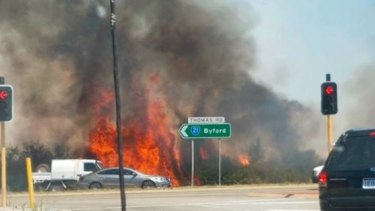 The fire burned through bushland close to the freeway.
