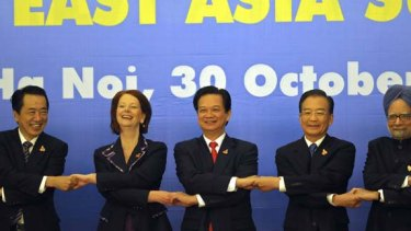Shake on it... (from left) Japanese Prime Minister Naoto Kan, Prim Minister Julia Gillard, Vietnamese Prime Minister Nguyen Tan Dung, Chinese Premier Wen Jiabao and Indian Prime Minister Manmohan Singh at the 17th ASEAN summit in Hanoi.