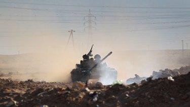 Civil war ... a rebel tank  near the oil town of Ras Lanuf.