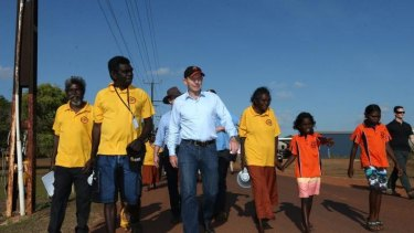 Tony Abbott joins school attendance officers.