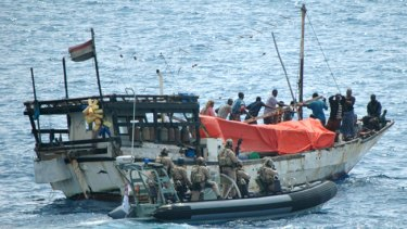 The boarding party from HMAS Stuart comes alongside the dhow that had been seized by Somali pirates, who held three Yemenis captive. :