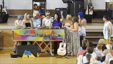 Celebration of life: Zac Young's family say goodbye with the help of song.