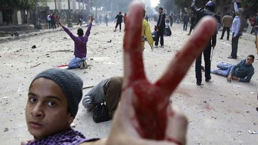 V for victory: A protester in Tahrir Square, Cairo.