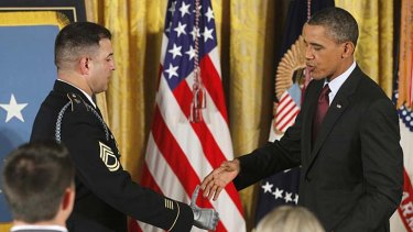 The President shakes the prosthetic hand of Ranger Leroy Petry.