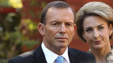"The carbon tax has a ""devastating"" impact ... Opposition Leader Tony Abbott and Senator Michaelia Cash."