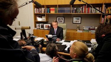 Tough times ... the Treasurer, Wayne Swan, poses with this year's budget papers.
