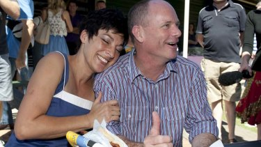 Campbell Newman and Lisa Newman enjoy a sausage sizzle after casting their votes for the Queensland State Election.