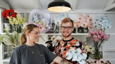 """""""I would definitely get more business,"""" says florist Emily Smith, pictured with stylist Ruben Stewart."""