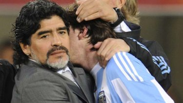 Hard to take ... Diego Maradona hugs Argentina's striker Lionel Messi after the loss to Germany.