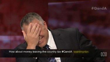 'Duh' ... Australian Treasurer Joe Hockey laughs during <i>Q&A</i>'s show on intergenerational wealth and health.