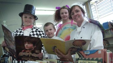 Book Week at the Teralba Public School ...  Logan Douglas, Mitchell Bailey and  Emilee Windle with librarian Louise Southward.