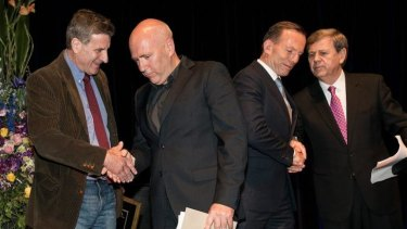 Joint fiction award winners, Steven Carroll (left) and Richard Flanagan, with the Prime Minister Tony Abbott and awards host Ray Martin.