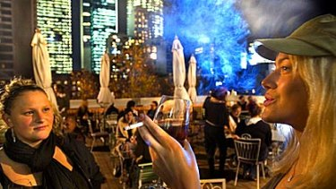 Patrons smoke at Madam Brussels rooftop bar in 2008.