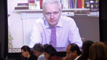 Julian Assange addresses the United Nations General Assembly via videolink.