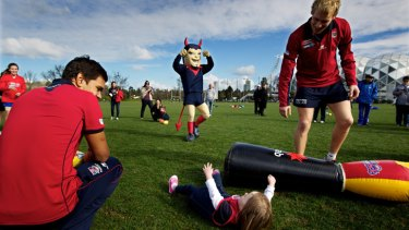 Melbourne players, pictured hosting an all-girl NAB AFL Auskick clinic, need to improve their use of the ball, says Garry Lyon.