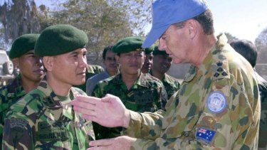 Then Australian Army Brigadier Duncan Duncan Lewis, right, in 2000, as United Nations Commander Sector West in East Timor, meeting his Indonesian counterpart Colonel Indra Hidayat.