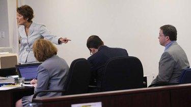 Accused ... prosecutor Elizabeth Keeley, left, points to Mark Kerrigan, right, brother of Olympic figure skater Nancy Kerrigan.