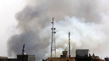 Smoke billows from a petrol depot that has been ablaze four days following clashes between rival militias near the airport in the Libyan capital Tripoli.