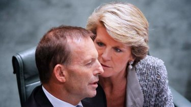 Julie Bishop talks to Prime Minister Tony Abbott. The Coalition says the Environment Department will provide independent advice and analysis on climate change.