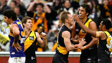 Richmond players congratulate Jack Riewoldt on his way to a 10-goal haul against the West Coast Eagles.