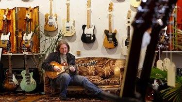 Great moments ... Steve Jackson plays a rare 1959 Les Paul Gibson guitar worth $600,000.
