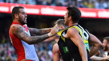 Shirt front: Lance Franklin tussles with Richmond's Alex Rance.