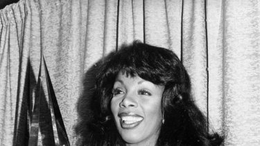 Donna Summer poses with three awards she won at the American Music Awards in 1979.