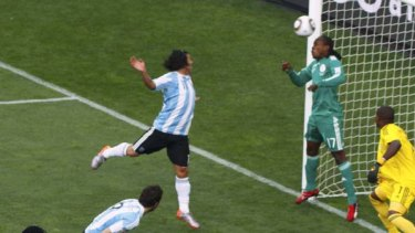 Nigeria's goalkeeper Vincent Enyeama stands helpless as Gabriel Heinze's bullet-like header finds the net.