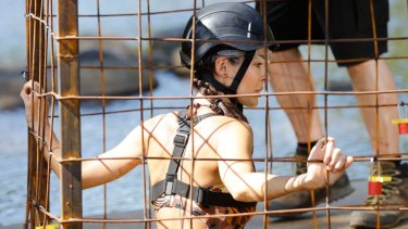 Former I'm A Celebrity contestant Laurina Fleure is lowered into crocodile-infested waters.