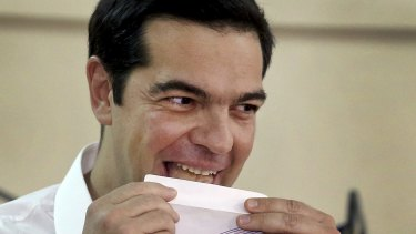 Greek Prime Minister Alexis Tsipras votes at a polling station in Athens on Sunday.