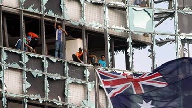 Flashback ... workers remove broken glass from the Australian  embassy in Jakarta after a bombing in 2004.