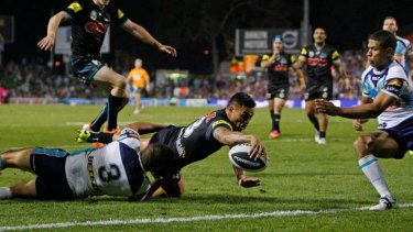 Black magic: Dean Whare goes over for the first try of the night for the Panthers