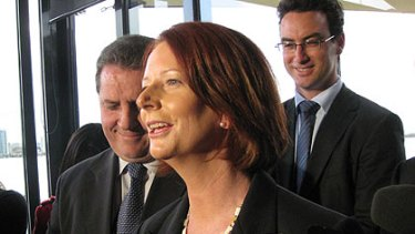 Julia Gillard laughs off an earlier egging incident during her visit to to Perth.