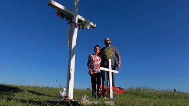 Waiting: Michelle's mother Loraine Bright with her son, Les, at the site where Michelle's body was found 15 years ago.