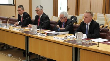 Gary McLaren, Greg Adcock, Kevin Brown and Kieren Cooney from NBN Co appear before a Senate hearing at Parliament House in 2013.