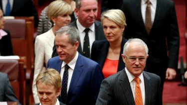 Prime Minister Malcolm Turnbull and Opposition Leader Bill Shorten arrive for the opening of the second session of the 44th Parliament, in the Senate.