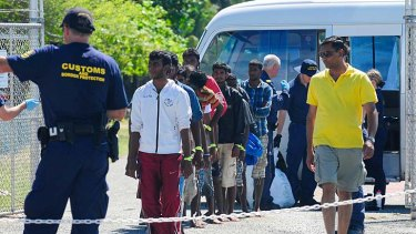 Lined up ... asylum seekers at the Cocos Islands.