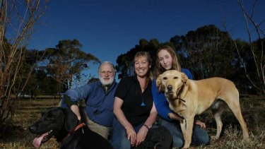 Team effort ... Peter, Kate and Rita Marshall with their truffle dogs Shadow and Sal, on their truffle farm near Braidwood.