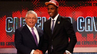 Kyrie Irving (right) greets NBA commissioner David Stern after he was selected number one overall by the Cleveland Cavaliers in the first round during the 2011 US NBA Draft.