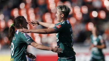 United's Michelle Heyman, right, celebrates with teammate Hayley Raso after scoring a goal against Japan's NTV Beleza.
